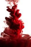Verf in water, rode kleurrijk Stock Foto