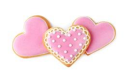 Verfraaide hart gevormde koekjes op witte achtergrond stock afbeeldingen