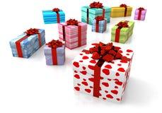 Verfraaide pakketten met rood lint Stock Afbeeldingen