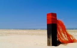 Verfraaide strandpost stock afbeeldingen