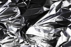 Verfrommelde zilveren folie Stock Afbeeldingen