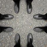 Vergadering van vier zakenlieden Stock Afbeelding
