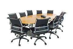 Vergaderingslijst en zwarte haren in vergaderzaal Stock Afbeelding