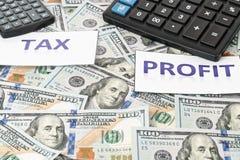 Vergelijking van de belasting en de winsten royalty-vrije stock afbeelding