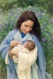 Vergine Maria sorridente con il bambino Fotografia Stock Libera da Diritti