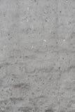 Vergipste Wände des verlassenen Gebäudes, gesehene zerstreute kleine Steine, Beschaffenheiten Stockfotos