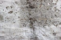 Vergipste Wand mit Bürstenanschlägen lizenzfreies stockfoto