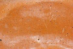 Vergipste Wand mit Bürstenanschlägen Stockfoto