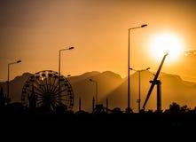 Vergnügungspark bei Sonnenuntergang Stockbilder
