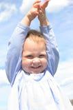 Vergnügtes Baby. Stockbild