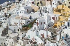 Vergoelijkte Huizen in Oia, Santorini, Cycladen, Griekenland royalty-vrije stock foto