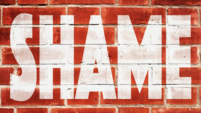 Vergogna su un muro di mattoni Immagini Stock