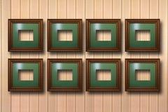 Vergoldete Holzrahmen für Bilder auf Hintergrund Stockfotos