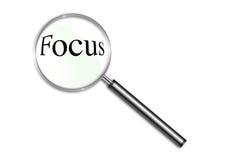 Vergrößerungsglas über dem Wort Fokus Lizenzfreies Stockfoto