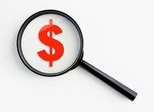 Vergrößerungsglas mit Dollarsymbol Stockfoto