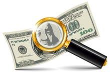 Vergrößerungsglas und Dollar Lizenzfreie Stockfotografie