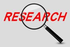 Vergrößerungsglas- und Forschungswort Lizenzfreie Stockfotos