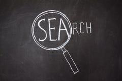 Vergrößerungsglas- und 'Such' Wort Lizenzfreies Stockfoto