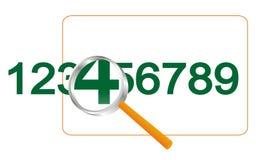 Vergrößerungsglas und Zahlen. Stockfotos