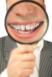Vergrößerungslächeln Stockbild