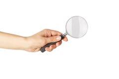 Vergrootglas in de geïsoleerde hand, stock fotografie