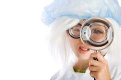 Vergrootglas en een Kind Stock Foto's