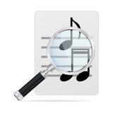 Vergrootglas en muzieknoten Stock Foto