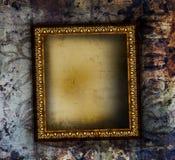Verguld frame op grunge Stock Foto
