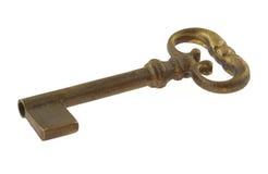 Vergulde antieke sleutel stock afbeelding