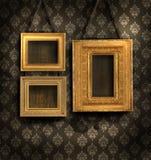 Vergulde frames op antiek behang Stock Afbeelding