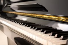 Verical black piano stock photo