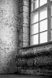 Grey old room. Verical photo grey-white old neglected interior room with big window Royalty Free Stock Image