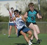Verificação bem sucedida do Lacrosse das meninas Fotografia de Stock