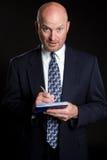 Verificación de la escritura del hombre de negocios Foto de archivo