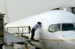 Verificación del aeroplano imagenes de archivo