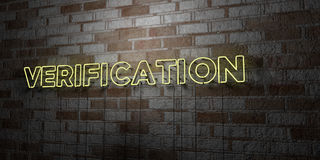 VERIFICATION - Glowing Neon Sign on stonework wall - 3D rendered royalty free stock illustration. Can be used for online banner ads and direct mailers Royalty Free Stock Image