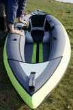 Verification of the good swelling of the inflatable kayak stock image