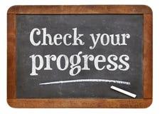 Verifique seu sinal do quadro-negro do progresso Imagens de Stock