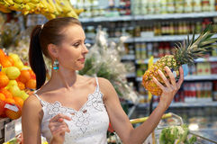 Verifying. Brunette beauty while shopping Royalty Free Stock Photos