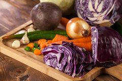 Verious fresh vegetables on a wooden table, healthy food.  royalty free stock photo