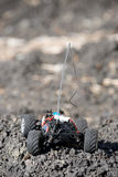 Veritcal of toy RC truck on dirt mound, no body Stock Image