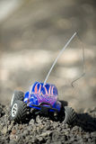 Veritcal of toy RC truck on dirt mound. On a sunny day Stock Photos