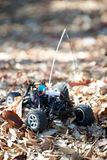 Veritcal of toy RC truck in leaves, no body. In partial shade Royalty Free Stock Photos