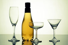 Verity wine glasses with beer bottle Stock Photos