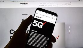 Verizon 5g official web page on a cellphone. MONTREAL, CANADA - SEPTEMBER 13, 2018: A hand holding a cellphone with opened Verizon 5g official web page. Verizon royalty free stock images