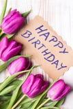 Verjaardagskaart en tulpenboeket Royalty-vrije Stock Afbeelding