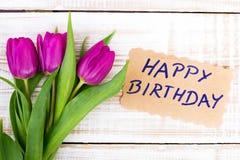 Verjaardagskaart en tulpenboeket Royalty-vrije Stock Foto