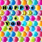 Verjaardagskaart met kleurensuikergoed en tekst Royalty-vrije Stock Foto's