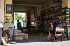 Verkäufe, die auf der Straße malen Lizenzfreie Stockfotografie