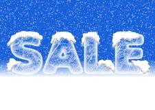 Verkäufe, die in den Eisbuchstaben mit Schnee beschriften Lizenzfreies Stockbild